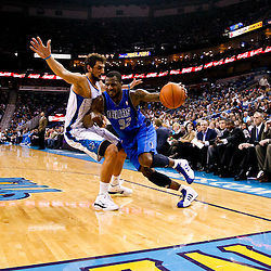 November 17, 2010; New Orleans, LA, USA; Dallas Mavericks shooting guard DeShawn Stevenson (92) drives past New Orleans Hornets shooting guard Marco Belinelli (8) of Italy during the first quarter at the New Orleans Arena. Mandatory Credit: Derick E. Hingle