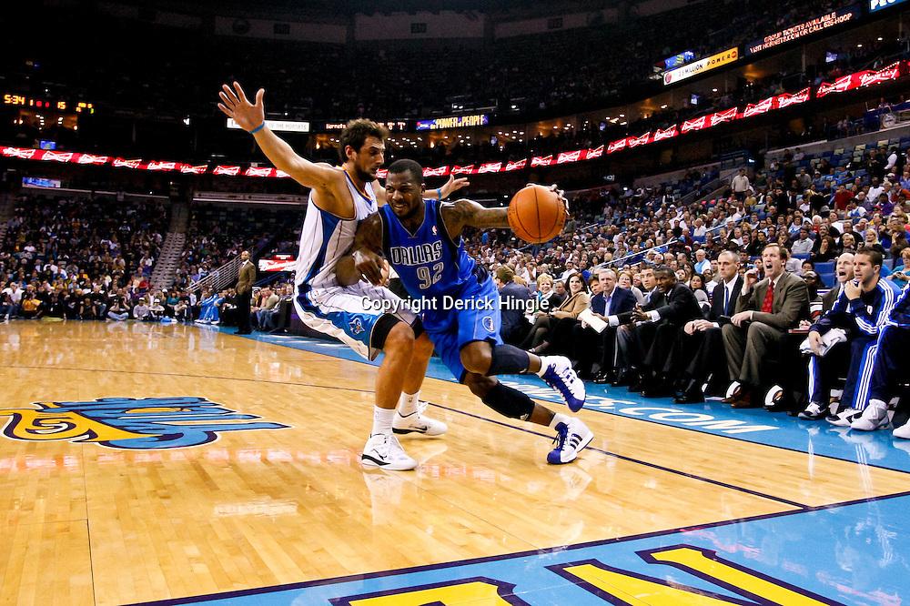 November 17, 2010; New Orleans, LA, USA; Dallas Mavericks shooting guard DeShawn Stevenson (92) drives past New Orleans Hornets shooting guard Marco Belinelli (8) of Italy during the first quarter at the New Orleans Arena. Mandatory Credit: Derick E. Hingle