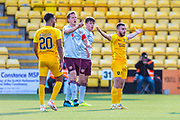 Christophe Berra (#6) of Heart of Midlothian FC and Steven Lawless (#11) of Livingston FC appeal to the referee during the Ladbrokes Scottish Premiership match between Livingston FC and Heart of Midlothian at the Tony Macaroni Arena, Livingston, Scotland on 26 October 2019.