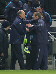 MANCHESTER, ENGLAND - WEDNESDAY, JANUARY 4th, 2006: Manchester City's manager Stuart Pearce and Tottenham Hotspur's Martin Jol embrace after the final whistle during the Premiership match at the City of Manchester Stadium. (Pic by David Rawcliffe/Propaganda)