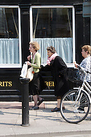 Elderly woman being assisted along the street by another woman in Dublin Ireland