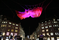 © Licensed to London News Pictures. 14/01/2016. London, UK. A giant illuminated net sculpture entitled '1.8 London' hangs above Oxford Circus. Lumiere London is a major new light festival that, over four evenings, brings together<br />