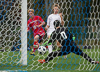 Laconia's Aidan Dean makes the goal against Gilford's Nolan Dwyer during NHIAA Division III soccer on Wednesday afternoon.  (Karen Bobotas/for the Laconia Daily Sun)
