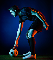 one caucasian Soccer player Man isolated on black backgound