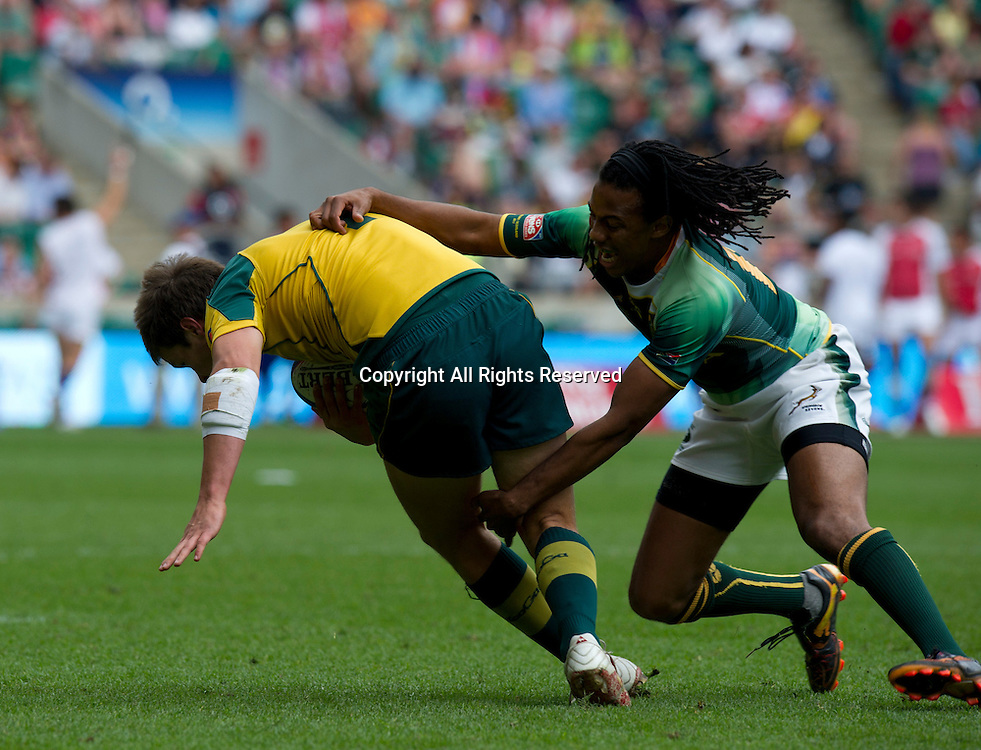 22.05.2011 Cecil Afrika (RSA) tackles Hamish Angus  at the Rugby Union HSBC Sevens World Series from Twickenham.