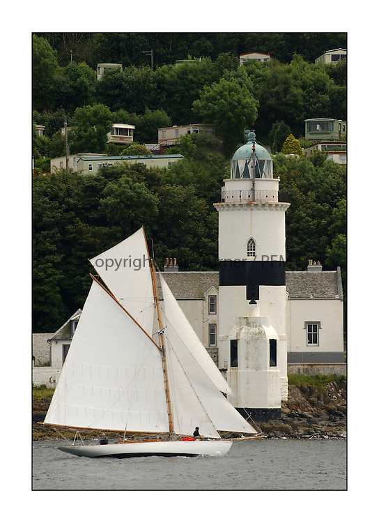 Viola, a 49' gaff Cutter is regarded a French National Monument which normally resides in La Rochelle. Built originally for an cleint of Wm Fife in Kilcreggan. Sailing here past the Cloch Lighthouse...This the largest gathering of classic yachts designed by William Fife returned to their birth place on the Clyde to participate in the 2nd Fife Regatta. 22 Yachts from around the world participated in the event which honoured the skills of Yacht Designer Wm Fife, and his yard in Fairlie, Scotland...FAO Picture Desk..Marc Turner / PFM Pictures
