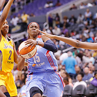 08 August 2014: Atlanta Dream guard Tiffany Hayes (15) drives past Los Angeles Sparks guard Candice Wiggins (2) and Los Angeles Sparks forward/center Sandrine Gruda (7) during the Los Angeles Sparks 80-77 overtime win over the Atlanta Dream, at the Staples Center, Los Angeles, California, USA.