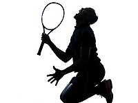 on man african afro american playing tennis player kneeling screaming on studio isolated on white background
