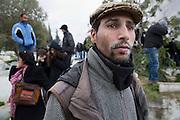 Manifestant anonyme au cimetiere Jallez, qui utilise de la farine contre le gaz lacrymogene. l'hommage du peuple Tunisien a Chokri Belaid fut perturbe par incidents entre jeunes casseurs et la police anti-emeutes. Des voitures sont brulées.