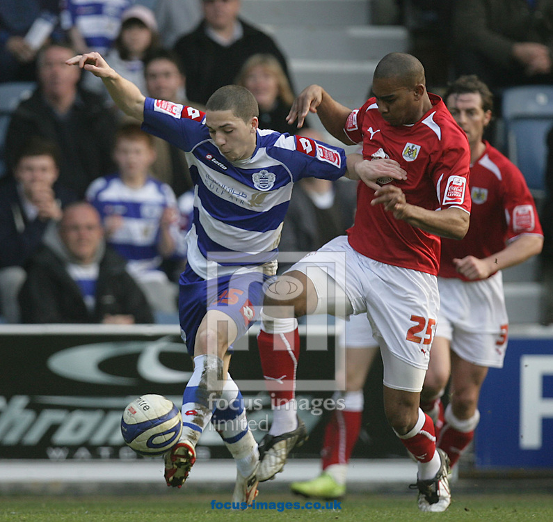 London - Saturday March 21st, 2009: Hogan Ephraim (L) of QPR in action against Marvin Elliott of Bristol City during the Coca Cola Championship match at Loftus Road, London. (Pic by Mark Chapman/Focus Images)