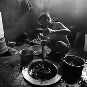 A woman makes pork sausages in Ha Giang, Vietnam's northernmost province, 20 June, 2007. As cities like Hanoi and Ho Chi Minh roar with Vietnam's economic boom, Ha Giang remains a quiet, serene and beautiful mountain backwater along the Chinese border.