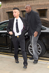 © Licensed to London News Pictures. 18/06/2014. Chelmsford , UK.  N-Dubz  pop group member Dino Costas Contostavlos aka 'Dappy' (left) , with his minder arriving at Chelmsford Magistrates Court in Essex where he is accused of attacking a man in the early hours of 27 February and is due to stand trial. Photo credit Simon Ford/LNP