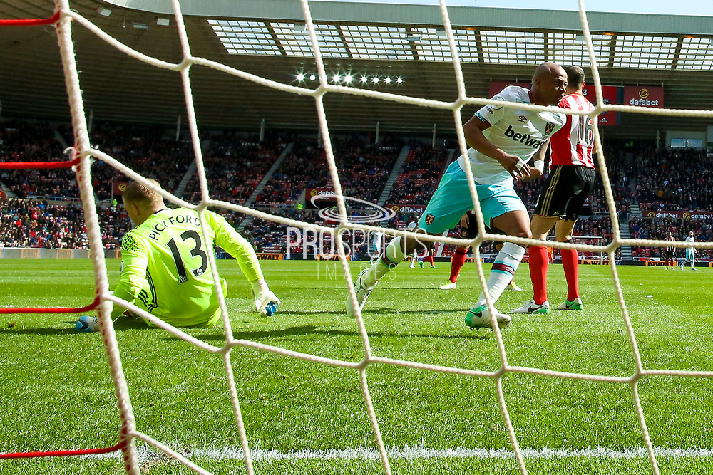 West Ham United Forward Andre Ayew (20) scores a goal and celebrates to make the score 0-1 during the Premier League match between Sunderland and West Ham United at the Stadium Of Light, Sunderland, England on 15 April 2017. Photo by Simon Davies.