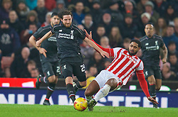 STOKE-ON-TRENT, ENGLAND - Tuesday, January 5, 2016: Liverpool's Joe Allen in action against Stoke City's Glen Johnson during the Football League Cup Semi-Final 1st Leg match at the Britannia Stadium. (Pic by David Rawcliffe/Propaganda)