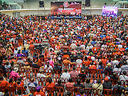 "23 FEBRUARY 2014 - NAKHON RATCHASIMA (KORAT), NAKHON RATCHASIMA, THAILAND: Thai Red Shirts gather in Liptapunlop Hall in Nakhon Ratchasima. The United front of Democracy against Dictator (UDD or Red Shirts), which supports the elected government of Yingluck Shinawatra, staged the ""UDD's Sounding of the Battle Drums"" rally in Nakhon Ratchasima (Korat) to counter the anti-government protests that have gripped Bangkok since November. Around 4,000 of UDD's regional and provincial coordinators along with the organization's core members met at Liptapunlop Hall inside His Majesty the King's 80th Birthday Anniversary Sports Complex in Korat to discuss the organization's objectives and tactics against anti-government protestors, which the UDD says ""seek to destroy the country's democracy."" The UDD leadersa announced that they will march to Bangkok and demonstrate against anti-government protests led by Suthep Thaugsuban.   PHOTO BY JACK KURTZ"