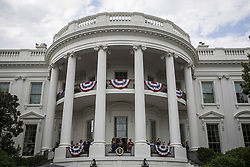 July 4, 2017 - Washington, District of Columbia, United States of America - United States President Donald J. Trump delivers remarks as first lady Melania Trump looks on from the Truman Balcony on July 4, 2017, in Washington, DC. The president was hosting a picnic for military families for the Independence Day holiday.  .Credit: Zach Gibson / Pool via CNP (Credit Image: © Zach Gibson/CNP via ZUMA Wire)