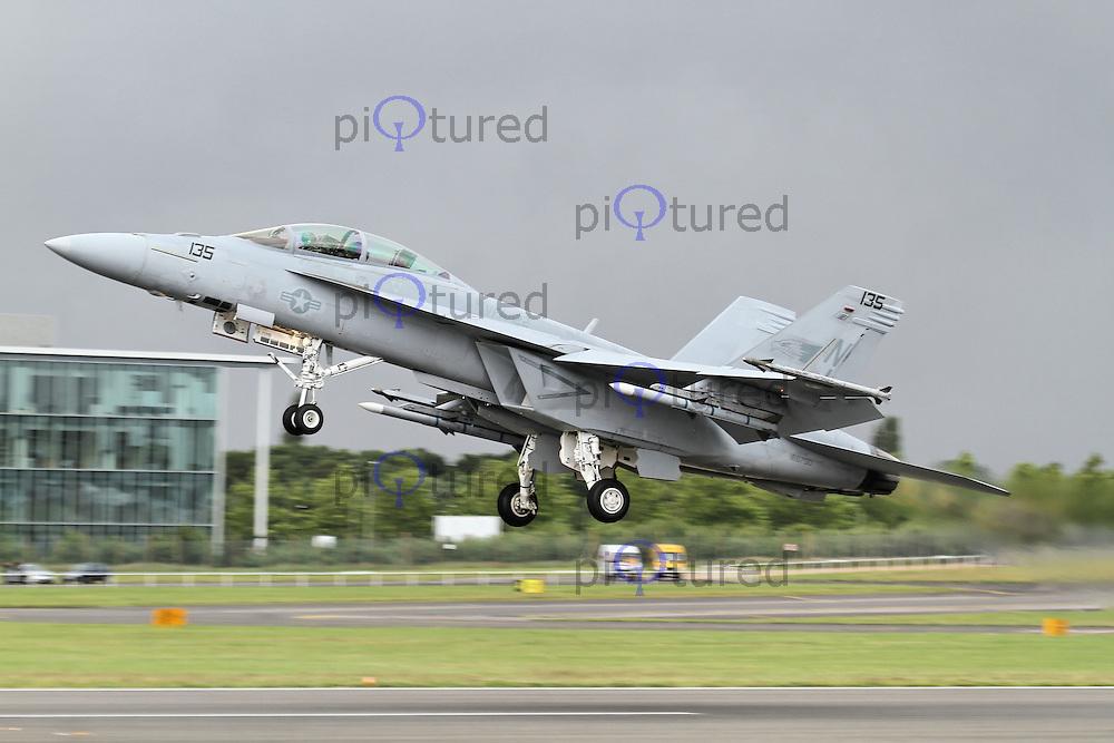 FARNBOROUGH - JULY 13: U.S. Navy McDonnell Douglas F-18 FA-18F Super Hornet at the Farnborough International Airshow, Farnborough Airport, UK. July 13, 2012. (Photo by Richard Goldschmidt)
