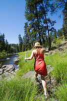 Young woman fly fishing on the John Day River, OR.