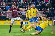 Jason Kerr (#15) of St Johnstone FC blocks a shot from Aidan Keena (#35) of Heart of Midlothian FC during the Ladbrokes Scottish Premiership match between Heart of Midlothian FC and St Johnstone FC at Tynecastle Park, Edinburgh, Scotland on 14 December 2019.