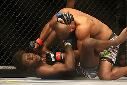Pope Djembo (Red) punches Regis Muyambo (Blue) down during the third bout of the Extreme Fighting Championships, EFC 52 held at the Grand West Casino in Cape Town, South Africa on the 5th August 2016<br /> <br /> Photo by:   Shaun Roy / Real Time Images