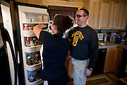 John Daniel Shannon, 48, a former US Army Senior Sniper, is helping his wife Torrey Shannon, 42, in their kitchen in Westcliffe, CO, USA, where he retired with his family after a serious brain injury inflicted by an insurgent sniper in Ramadi, Al Anbar Province, Iraq, on November 13th 2004. Daniel fought during the Second Battle of Fallujah and was then moved to nearby Ramadi. Daniel lost his left eye and has multiple health issues because of his injury: memory problems, balance problems, he can't smell and taste well anymore, he suffers from PTSD, has  troubles with large crowds and city surroundings. This is the reason why he and his family moved to a quiet location on the Rocky Mountains. In 2007 Dan helped the Washington Post to uncover patients' neglect at the Walter Reed Army Medical Center; he also testified before Congress. Torrey, his wife, is a freelance writer and a contributor for the Huffington Post; she's also campaigning to improve the situation of veterans' families.