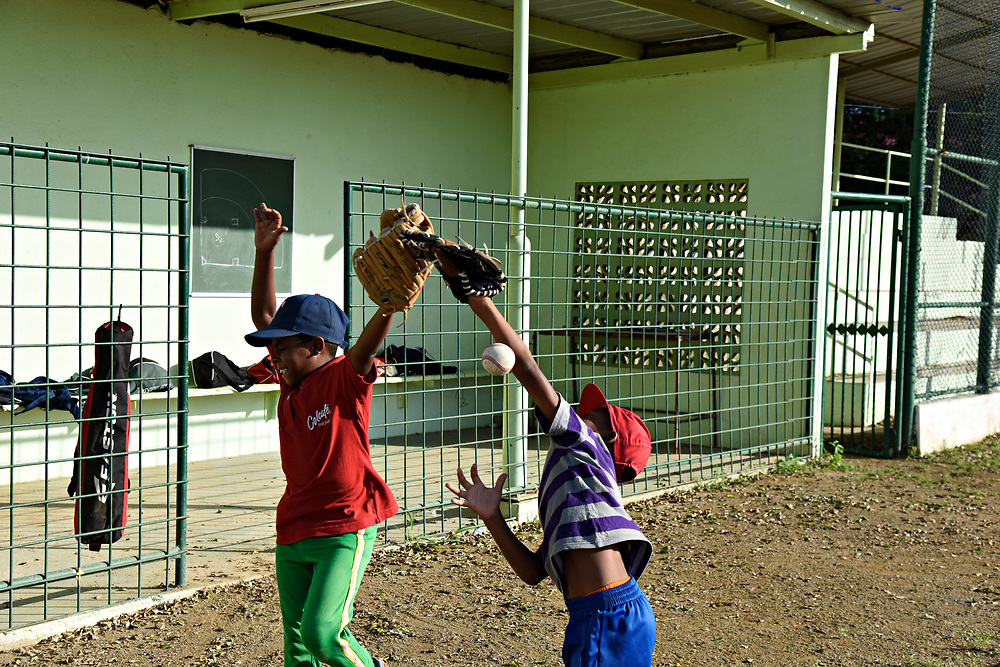 WILLEMSTAD, CURACAO - DECEMBER 11, 2014: The Marchena Hardware 7-9 year olds warm up trying to catch pop flys before practice actually began. (photo by Melissa Lyttle)