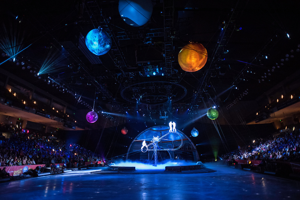 BALTIMORE, MD -- 4/21/17 -- The Simet Troupe perform the Simet Wheel Act in astronaut suits in the show's opening. The device, known as the Giant Semaphore, is the only one of it's kind. Ringling Bros, the self-proclaimed Greatest Show on Earth, is in the final leg of a 146 year run. The final performances will be held in May. Out of This World, one of two circus units, recently had performances in Baltimore, led by Jonathan Lee Iverson, the first African-American ringmaster in the show's history…by André Chung #_AC14644