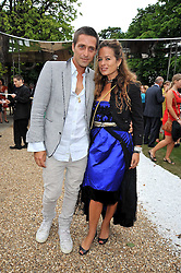 DAN WILLIAMS and JADE JAGGER at the annual Serpentine Gallery Summer Party sponsored by Canvas TV  the new global arts TV network, held at the Serpentine Gallery, Kensington Gardens, London on 9th July 2009.