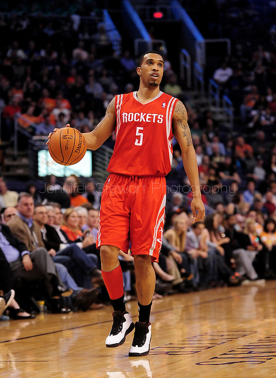 Feb. 9, 2012; Phoenix, AZ, USA; Houston Rockets guard Courtney Lee (5) dribbles the ball up the court while playing against the Phoenix Suns during the first half at the US Airways Center. The Rockets defeated the Suns 96-89. Mandatory Credit: Jennifer Stewart-US PRESSWIRE.