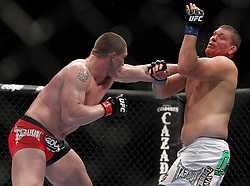 May 29, 2010; Las Vegas, NV; USA;  Todd Duffee (red/black trunks) and Mike Russow (white trunks) fight during their bout at UFC 114 at the MGM Grand Garden Arena in Las Vegas.