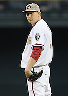 PHOENIX, AZ - MAY 27:  Pitcher Trevor Cahill #35 of the Arizona Diamondbacks pitches against the Texas Rangers in the second inning of an interleague game at Chase Field on May 27, 2013 in Phoenix, Arizona.  The Diamondbacks defeated the Rangers 5-4.  (Photo by Jennifer Stewart/Getty Images) *** Local Caption *** Trevor Cahill