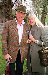 MR & MRS BRYAN MORRISON at a race meeting in<br />  Surrey on 28th April 2000.ODE 23
