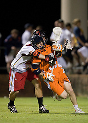 Virginia midfielder Peter Lamade (39) is held by Maryland midfielder Jeremy Sieverts (20).  The #3 ranked Virginia Cavaliers defeated the #8 ranked Maryland Terrapins 11-8 in the semi finals of the Men's 2008 Atlantic Coast Conference tournament at the University of Virginia's Klockner Stadium in Charlottesville, VA on April 25, 2008.