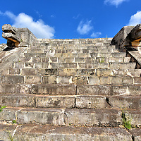 Platform of Venus at Chichen Itza, Mexico<br /> The Platform of Venus is another well-preserved, Toltec style structure in the Great Plaza nearest to El Castile. At the corners of the four staircases are the familiar statues of serpent heads acting as guardians. Unlike the other buildings, the upper base of Platforma de Venus is round, presumably to stage dances or ceremonies. Archeologists believe the Mayans at Chichen Itza accurately calculated the 583.92 day cycle of Venus dating back to the early 10th century during the Terminal Classic period. They then used the planet's rotation to schedule certain rituals. There is an additional Venus Platform near the Tomb of the High Priest (Ossuary).