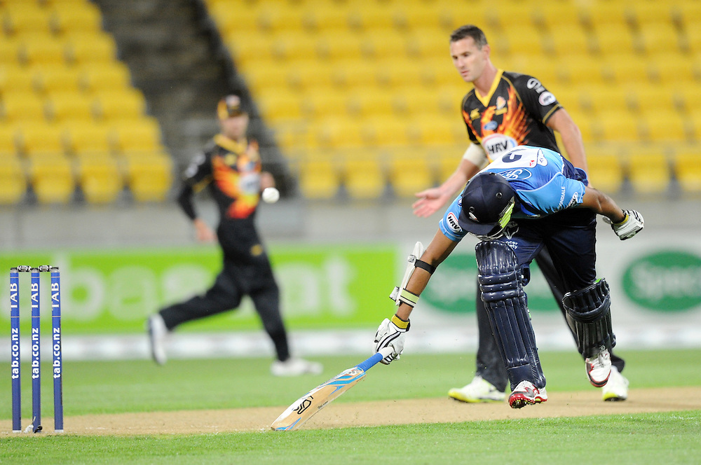 Auckland Aces Jeet Raval makes his ground watched by Wellington Firebirds Shaun Tait in the HRV T20 cricket match at Westpac Stadium, Wellington, New Zealand, Saturday, November 23, 2013. Credit:SNPA / Ross Setford