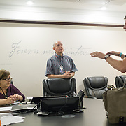 OCTOBER 6, 2017--PONCE, PUERTO RICO ---<br /> Allan Cintron Salichs, Executive Director of Med Centro in Ponce, and members of his management team listen to Direct Relief's Damon Taugher.<br /> (Photo by Angel Valentin/Freelance)