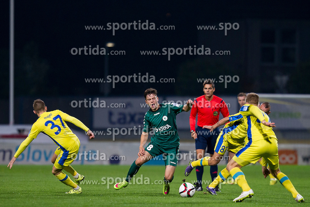 Zan Majer #37 of NK Domzale and Favour Aniekan #8 of NK Krka during football match between NK Domzale and NK Krka in 14th Round of Prva liga Telekom Slovenije 2015/16, on October 17, 2015 in Sports park Domzale, Slovenia. Photo by Urban Urbanc / Sportida