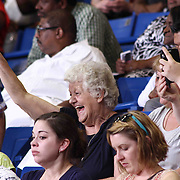 Family and friends in the stands celebrate during Delcastle high school commencement exercises Tuesday, May 26, 2015, at The Bob Carpenter Sports Convocation Center in Newark, Delaware