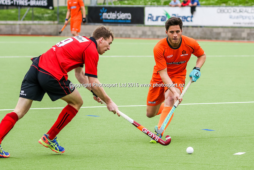 Canterbury's Cam Hayde is confronted by Midlands Leo Mitai-Wells. Midlands v Canterbury Men, FORD National Hockey League, ITM Hockey Centre, Whangarei, New Zealand. Friday 16 September, 2016. Copyright photo: Heath Johnson / www.photosport.nz