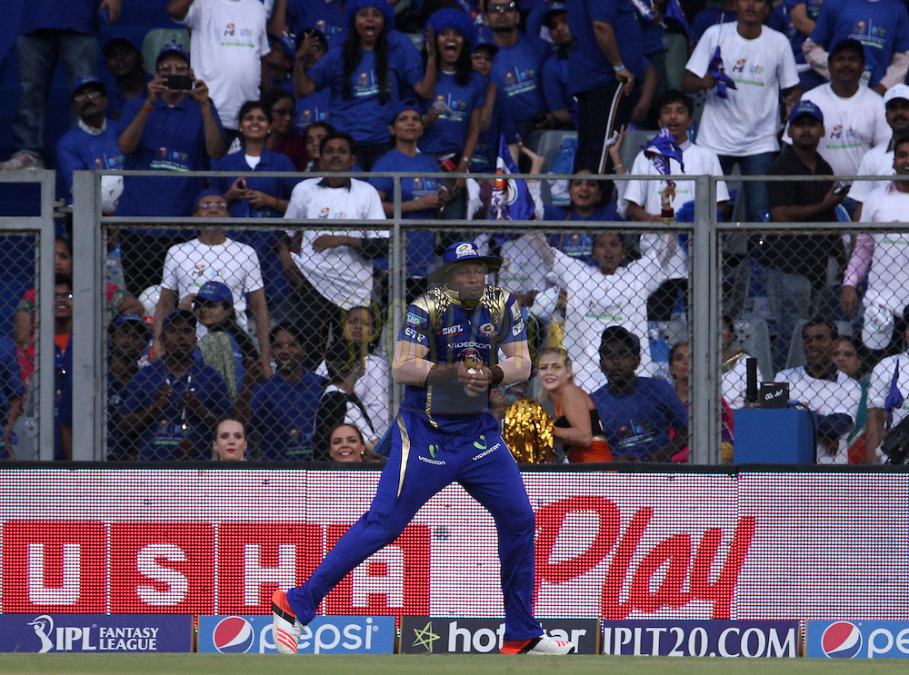 Mumbai Indians player Kieron Pollard takes the catch of Sunrisers Hyderabad player Naman Ojha during match 23 of the Pepsi IPL 2015 (Indian Premier League) between The Mumbai Indians and The Sunrisers Hyderabad held at the Wankhede Stadium in Mumbai India on the 25th April 2015.<br /> <br /> Photo by:  Vipin Pawar / SPORTZPICS / IPL