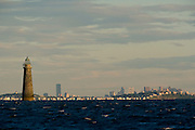 Minot's Ledge Lighthouse in front of Boston cityscape