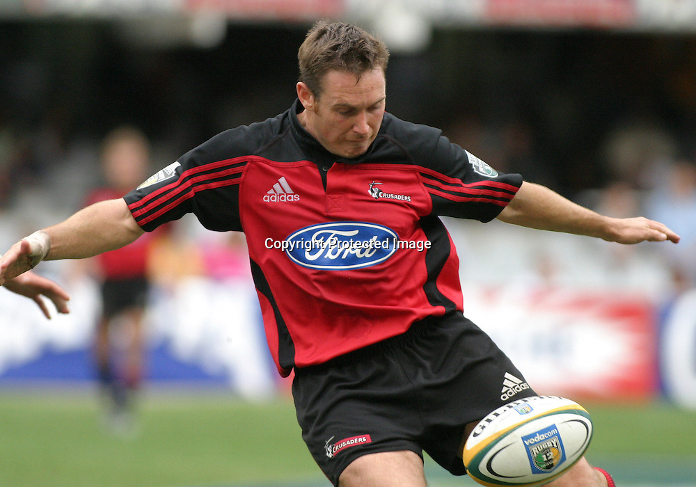 10 April, 2004. Rugby Union Super 12. Durban, South Africa. Crusaders v Sharks. Andrew Mehrtens looks to kick. The Sharks won the match, 29 - 25.<br /> Pic: Photosport