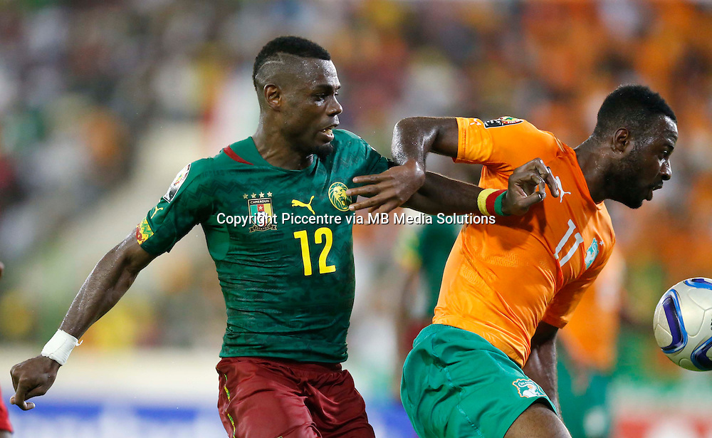 Henri Bedimo (L) of Cameroon contests against Gadji Celi Carmel of Cote de Ivoire during their AFCON group D match at Estadio de Malabo in Equatorial Guinea on January 28, 2015. Cote de Ivoire won 1-0. Photo/Mohammed Amin/www.pic-centre.com (Equatorial Guinea)