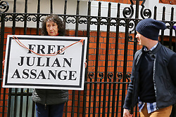 "© Licensed to London News Pictures. 05/04/2019. London, UK. A supporter of Julian Assange holds ""Free Julian Assange"" placard outside Ecuadorian Embassy in Knightsbridge. Media reports state that the Ecuadorian Embassy plan to remove Julian Assange, Wikileaks founder from the embassy within days. Julian Assange claimed political asylum in the Ecuadorean Embassy in June 2012 after he was accused of rape and sexual assault against women in Sweden. Photo credit: Dinendra Haria/LNP"