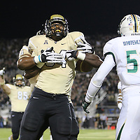 UCF Knights tight end Justin Tukes (84) celebrates a touchdown reception during an NCAA football game between the South Florida Bulls and the 17th ranked University of Central Florida Knights at Bright House Networks Stadium on Friday, November 29, 2013 in Orlando, Florida. (AP Photo/Alex Menendez)