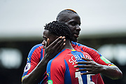 Jeffrey Schlupp (15) of Crystal Palace, Mamadou Sakho (12) of Crystal Palace, celebrate after scoring goal during the Premier League match between Fulham and Crystal Palace at Craven Cottage, London, England on 11 August 2018.