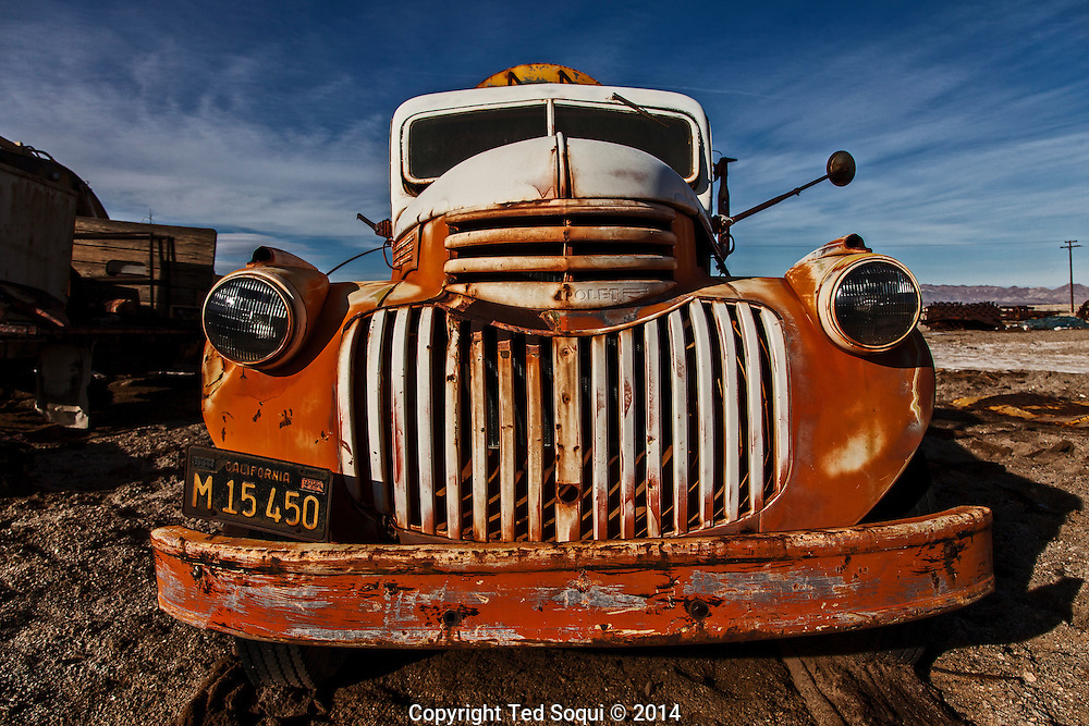An old truck parked inside the National Cloride Company.<br /> U.S. Route 66, also known as the Mother Road, in the Mojave desert of California. The two major connector cites in the Mojave desert are Barstow and Amboy. U.S. Route 66 was the first major east west highway for the US, starting in Chicago, Il and ending in Santa Monica, CA. The 2,448 mile long highway was built in November 11,1926. Most of Route 66 has been decommissioned, but there are several parts that are now historically preserved.