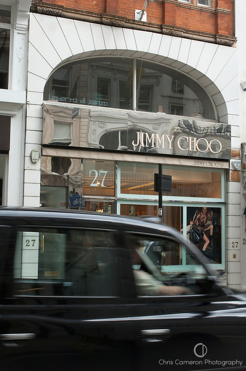 A Black Cab drives past the Jimmy Choo shoe shop in London. United Kingdom.