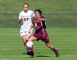 Boston College Eagles forward Gina DiMartino (5) is defended by Virginia Cavaliers midfielder/defender Nikki Krzysik (23).  The #9 ranked Virginia Cavaliers defeated the #13 ranked Boston College Eagles 2-1 in NCAA women's soccer at Klockner Stadium on the Grounds of the University of Virginia in Charlottesville, VA on October 19, 2008.