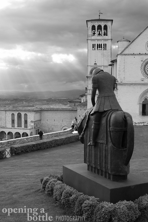 Statue in front of Basilica San Francisco de Assisi (Church of St. Francis), Assisi, Umbria, Italy. Full color image also available upon request.